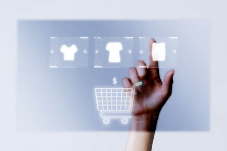 Person adding clothes to cart closeup for online shopping campaign